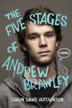 "Cover for The Five Stages of Andrew Brawley. Photo of a white boy with messy brown hair, hazel eyes, and freckles, wearing a gray hoodie on a gray background. A word bubble encases the words ""a novel"", hinting at the graphic novel elements within."