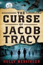 Cover for Holly Messinger's The Curse of Jacob Tracy. The title on paper like an Old West wanted poster. Above, bats flying in front of a full moon. Below, the silhouettes of two cowboys surrounded by ghostly figures.