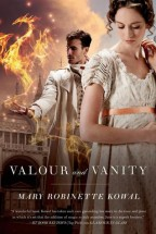 Cover for Valour and Vanity by Mary Robinette Kowal [a white woman with brown curly hair in an up-do stands in the foreground in a Edwardian floral summer dress. behind her is a dark-haired and -goateed man in a white Edwardian suit, his outheld hand performing a glamour of fiery orange lights in the shape of a dragon. A medieval European church can be seen in the background.]