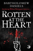 Cover for Rotten at the Heart by Bartholomew Daniels [a white, illustrated hand holding a dagger stabs upward; the dagger is covered in realistic-looking blood; the background is the black, leathery texture of an old book.]