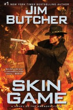 Cover for Skin Game by Jim Butcher. Our hero stands in the middle, in his classic black trenchcoat and black cowboy hat, all action stance as he shoots a gun to the left, his wizard's staff in his right hand. The background is a bank vault, burning money floating around, the whole scene awash in a fiery light.