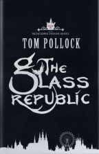 Cover for The Glass Republic by Tom Pollock. A black cover, with the title in large fancy silver letters in the center, and a silver London skyline running along the bottom edge.