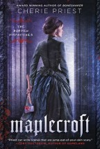 Cover for Maplecroft by Cherie Priest. A woman's whose blond hair is in a proper Victorian updo has her back to us as she stands between two forebodingly lit marble columns. She is wearing a fancy blue Victorian dress. In her left hand, held slightly behind her, she holds a bloody ax.