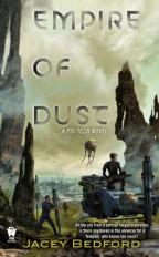 Cover for Empire of Dust by Jacey Bedford. An alien landscape with green sky and rocky terrain. A blond white woman in futuristic armor and holding a gun guards atop a floating transport while a black man behind her implants devises into the ground.