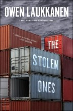 Cover for The Stolen Ones by Owen Laukkanen. A sinister photo of  stacked, large metal cargo crates. One is open and empty.
