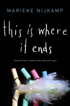 Cover for This Is Where It Ends by Marieke Nijkamp. Five brightly colored pieces of chalk explode in front of a chalkboard as they are hit with a bullet.
