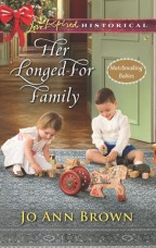 Cover for Her Longed-For Family by Jo Ann Brown. Two young white children play on a blue rug with old-fashioned toys, match-making babies series.
