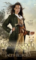 Cover for Winterwood by Jacey Bedford. A lady pirate with long brown hair and a sensible green coat holds a small wooden box, a white wolf looking on and the sea in the distance.