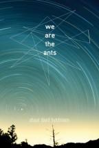 Cover for We Are The Ants by Shaun David Hutchinson. A photo of a yellow sunrise, the sky going from teal to navy as the stars blur in a their circular rotation.